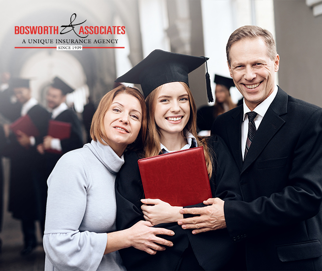 girl with parents on graduation day